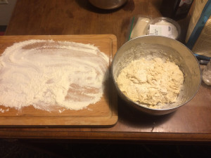 Getting ready to flip dough mix onto floured board